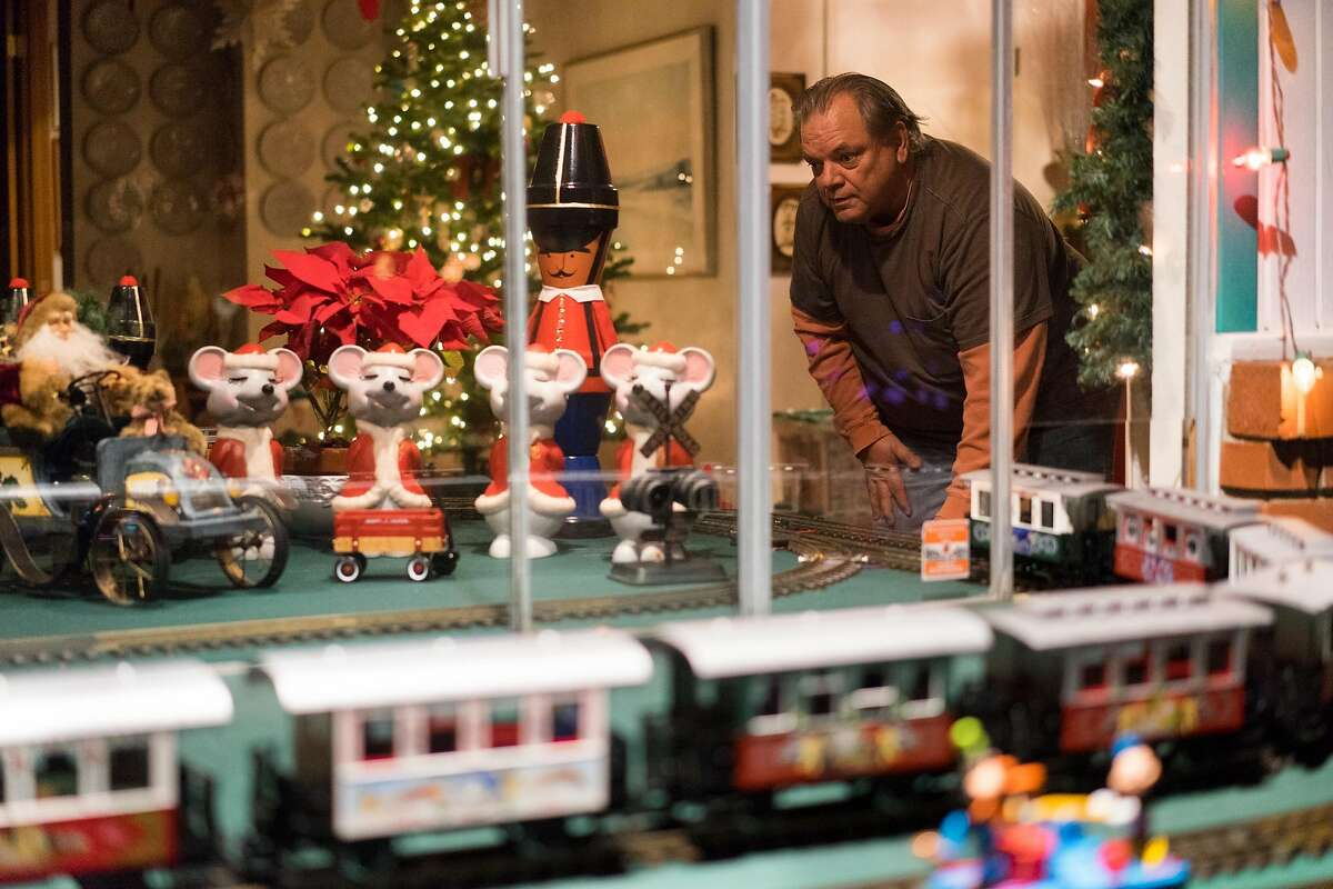 John Bianco sets up model trains at his late father's home in Mountain View, Calif on Tuesday, Dec. 22, 2015. The Bianco family has brought together residents of Mountain View and beyond with their annual model train display.
