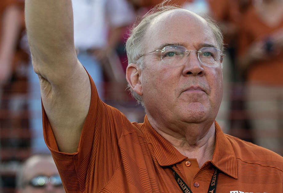 "Texas athletic director Mike Perrin, gives the ""Hook 'em Horns"" sign during a pregame performance by the UT marching band before the game against California at Royal-Memorial Stadium in Austin on Sept. 19, 2015. Photo: Rodolfo Gonzalez /Austin American-Statesman / Austin American-Statesman"