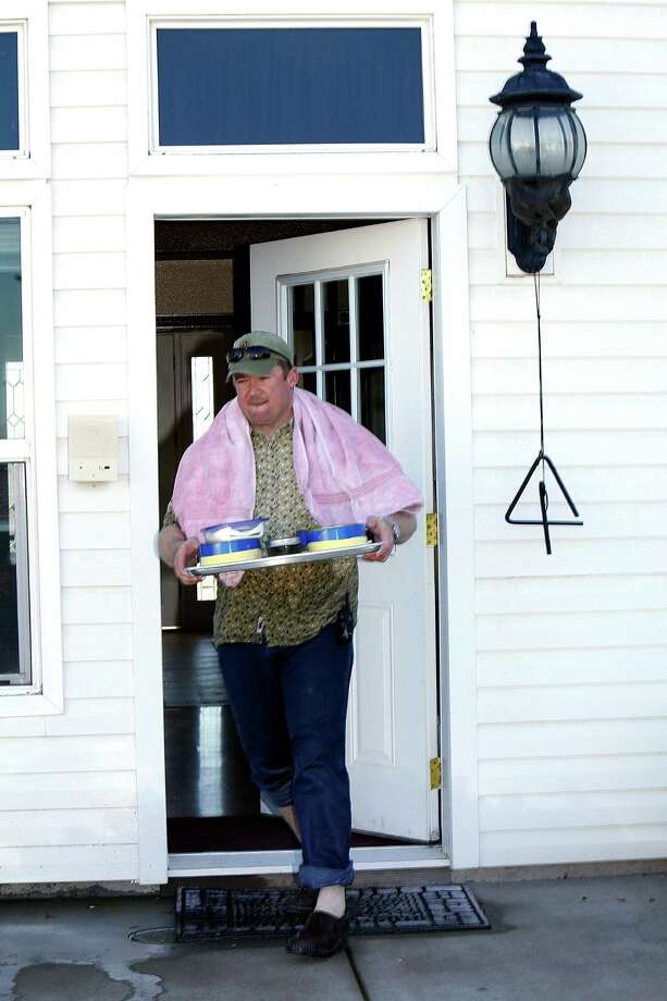 Caviar producer Michael Passmore brings out some of his packaged caviar on his ranch in Sloughhouse. Photo: Liz Hafalia / The Chronicle / ONLINE_YES