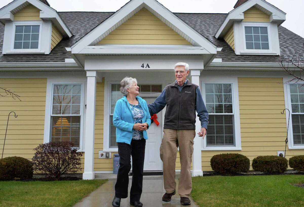 Barb and Bob Donnaruma outside their cottage at Shaker Pointe at Carondelet Wednesday Dec. 2, 2015 in Watervliet, NY. (John Carl D'Annibale / Times Union)