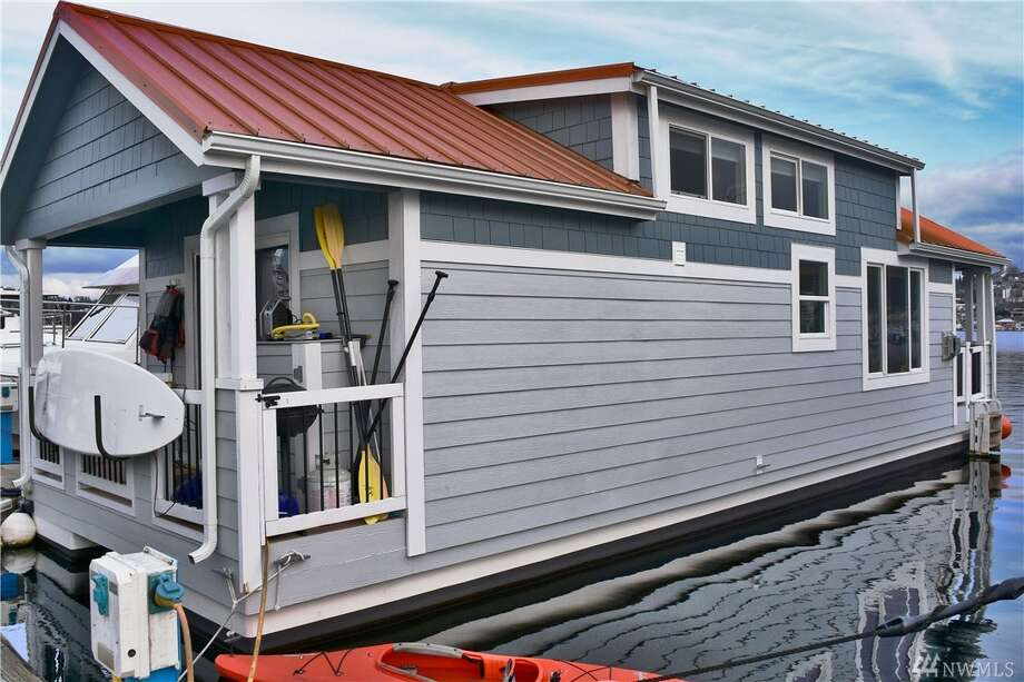 This floating home at 2000 Westlake Ave. N. is listed for $325,000. The two bedroom, .75 bathroom home features vaulted ceilings, a sleeping loft and sweeping views,  You can see the full listing here. Photo: Kevin Bagley