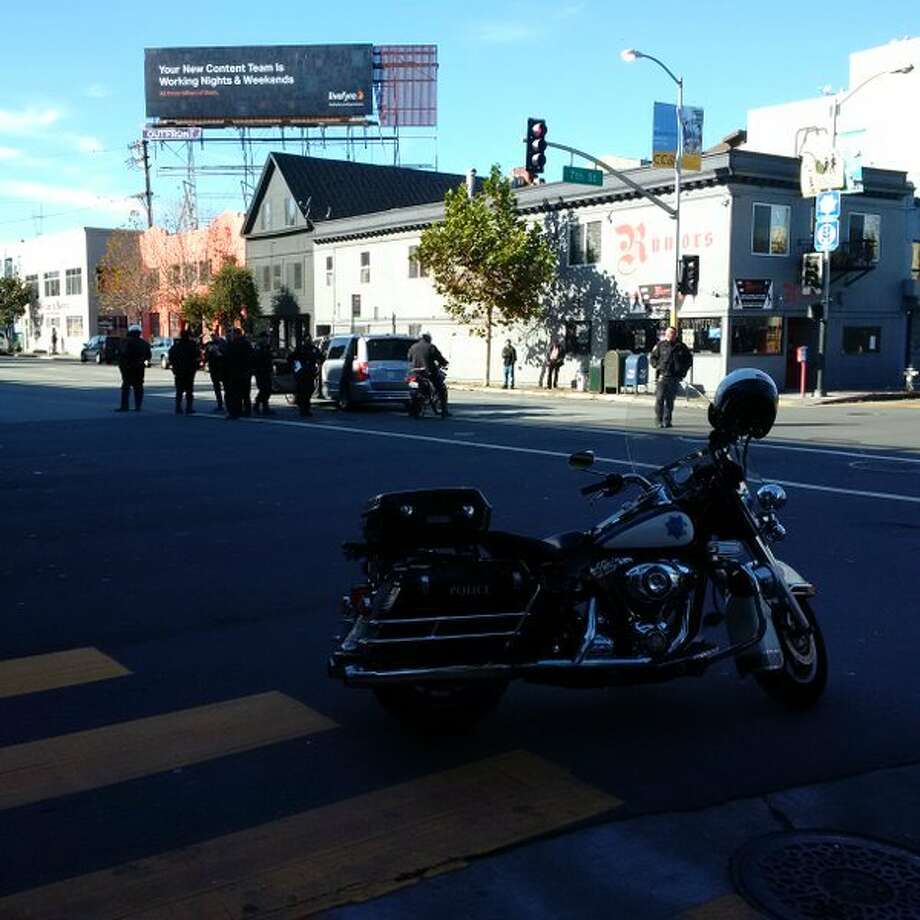 A San Francisco police motorcycle officer was struck and injured in a collision on Dec. 23, 2015 at Seventh and Harrison Streets. Photo: Sfpd
