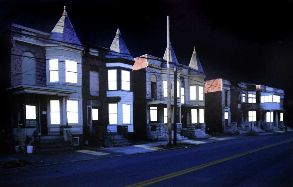 """TOP STORIES: """"Breathing Lights,"""" an installation conceived by artist Adam Frelin and architect Barbara Nelson that would place gently pulsing lights - mimicking respiration - inside hundreds of empty houses on the market. The full story here."""