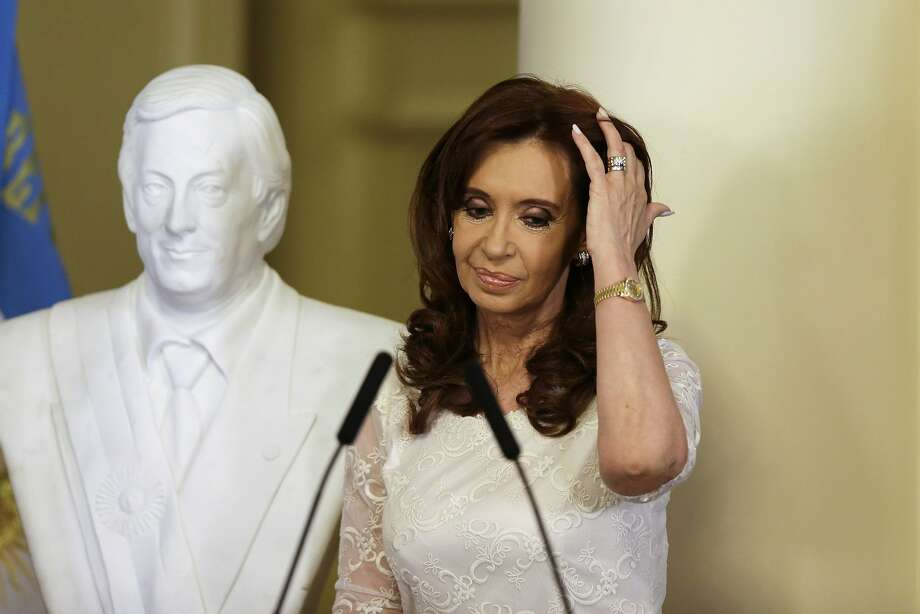 Former Argentine President Cristina Fernandez stands near a bust of her late husband, ex-President Nestor Kirchner. A businessman was elected president over her chosen successor. Photo: Ricardo Mazalan, Associated Press