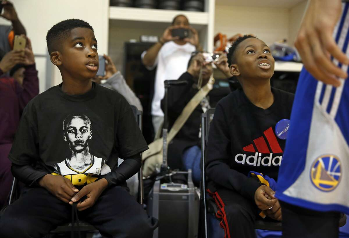 Make-A-Wish participants Qwavon Christian, 10, and Londell Francis, 11, meet Stephen Curry after watching Golden State Warriors' shootaround at Warriors' practice facility in Oakland, Calif., on Wednesday, December 23, 2015.