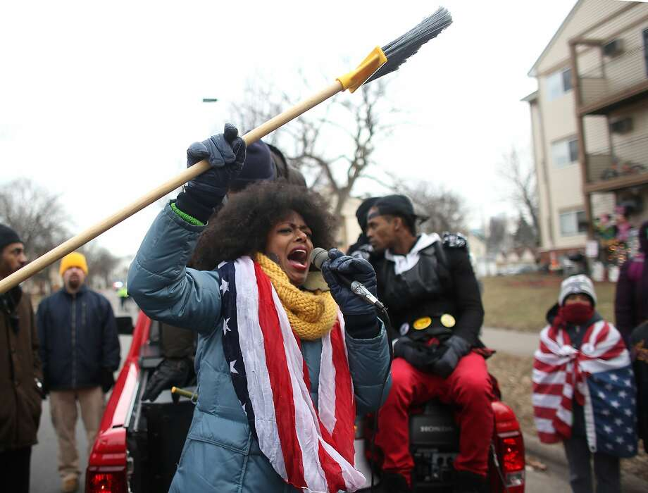Protesters demand the prosecution of police involved in the shooting death of a black man last month. Demonstrators stopped at the site where 24-year-old Jamar Clark was fatally shot. Photo: Kyndell Harkness, Associated Press