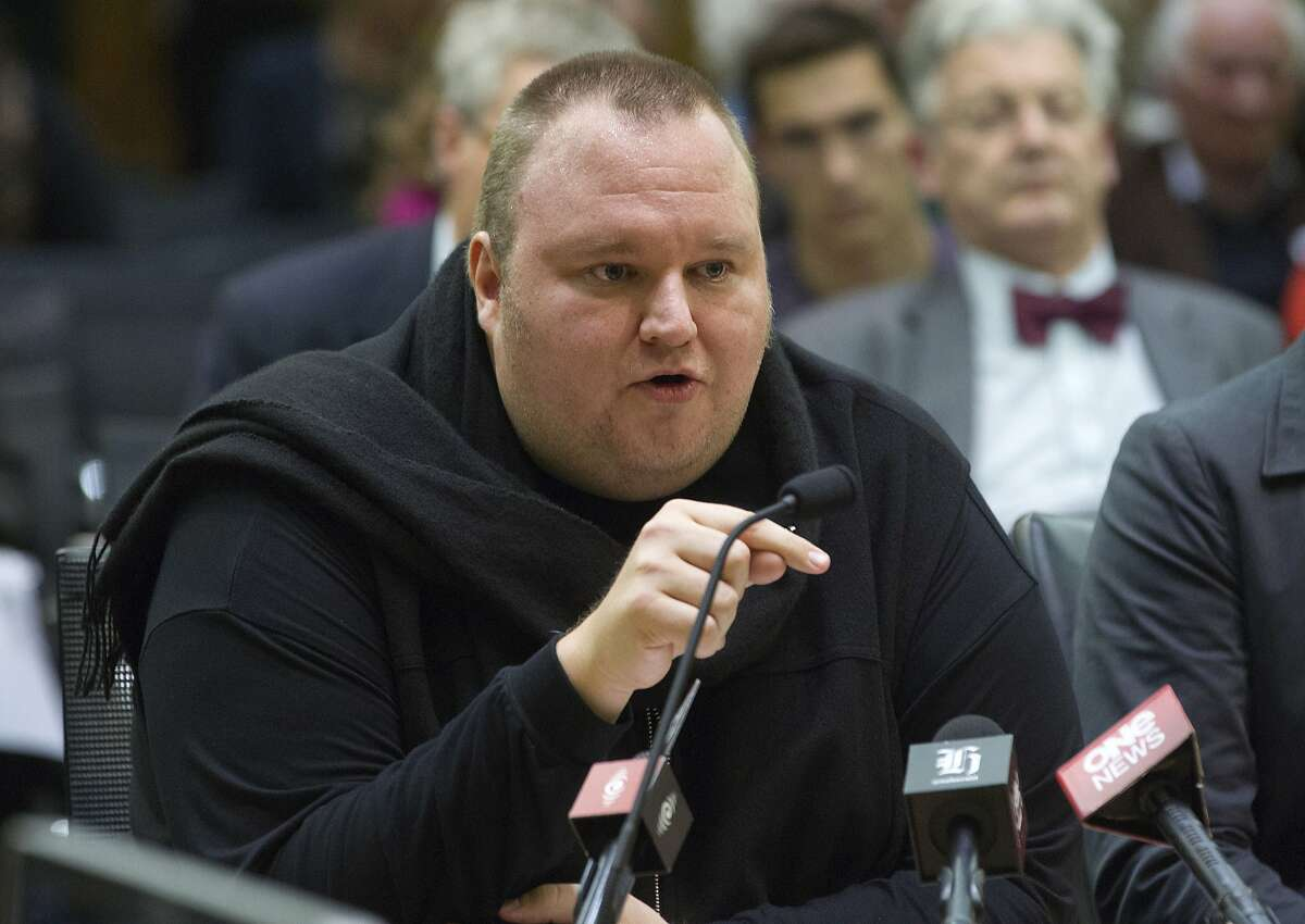 FILE - In this Wednesday, July 3, 2013 file photo, Internet entrepreneur Kim Dotcom speaks during the Intelligence and Security select committee hearing at Parliament in Wellington, New Zealand. A New Zealand judge has ruled that colorful Internet entrepreneur Kim Dotcom and three of his colleagues can be extradited to the United States to face criminal copyright charges. Dotcom's lawyers said they will appeal the decision. Judge Nevin Dawson's ruling on Wednesday, Dec. 23, 2015, comes nearly four years after U.S. authorities shut down Dotcom's Megaupload website, which some visitors had used to illegally download songs and movies.(Mark Mitchell/New Zealand Herald via AP, File) NEW ZEALAND OUT, AUSTRALIA OUT