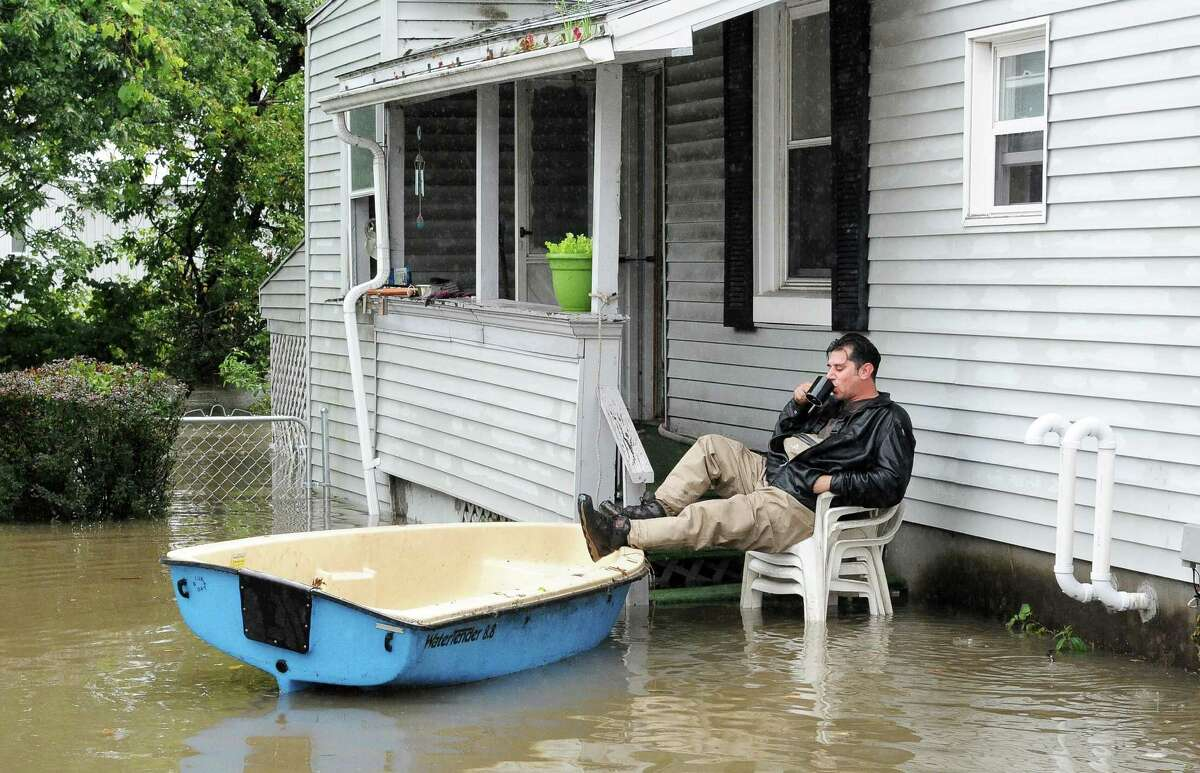 Anthony Catalano sips a coffee as he waits for the call to evacuate his Sumpter St. home Wednesday, Sept. 30, 2015, in Colonie, N.Y. (John Carl D'Annibale / Times Union)
