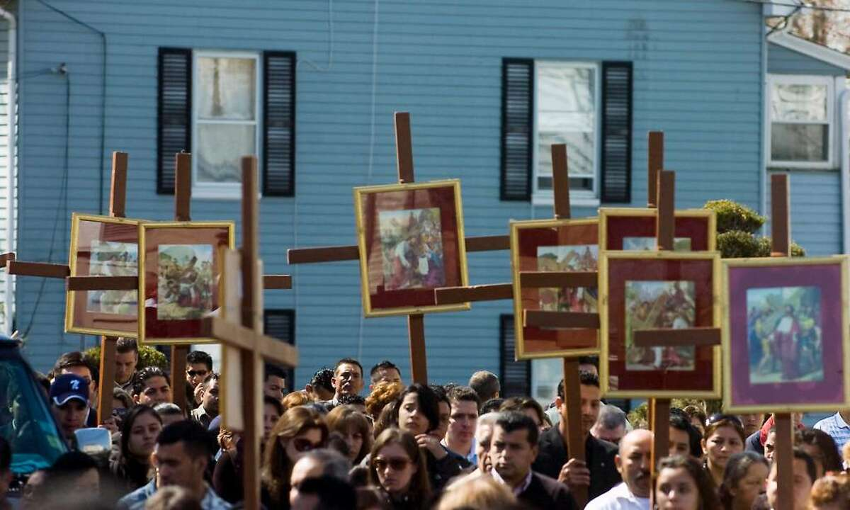 Parishioners and residents participate in the Good Friday Stations of the Cross procession from Cummings Beach to Our Lady of Montserrat Church in Stamford, Conn. on Friday April 2, 2010