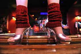 A dancer stands on the perimeter of the stage at Nite Moves on Monday, Nov. 23, 2015 in Latham, N.Y. (Lori Van Buren / Times Union)