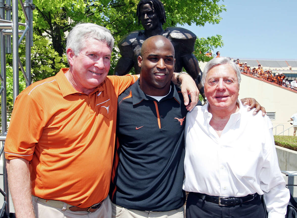 Former UT player and 1998 Heisman Trophy winner Ricky Williams (center) poses for photos with Longhorns head coach Mack Brown (left) and Texas mega-donor Joe Jamail during the dedication of the Ricky Williams statue before the Orange-White scrimamge on April 1, 2012 at Royal-Memorial Stadium in Austin.