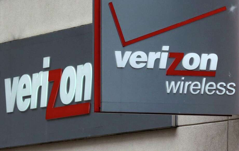 FILE - This June 4, 2014, file photo, shows signage at a Verizon Wireless retail store at Downtown Crossing in Boston. The country's biggest wireless company has said that its mobile video service, go90, launched in October 2015, will include sponsored content. That means Verizon customers watching the video will be exempt from data caps and Verizon charges advertisers. Spokeswoman Marie McGehee  confirmed a Re/code story that said Verizon will start testing sponsored data soon and plans to roll that out further next year. (AP Photo/Charles Krupa, File) Photo: Charles Krupa, STF / Associated Press / AP