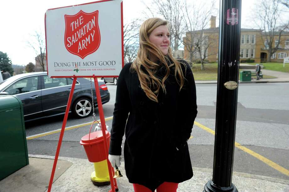Alex Vorder Bruegge of Greenwich, rings the bell for The Salvation Army on Greenwich Avenue in 2012. The group's kettle-based donations are down statewide. Photo: Helen Neafsey / Helen Neafsey / Greenwich Time
