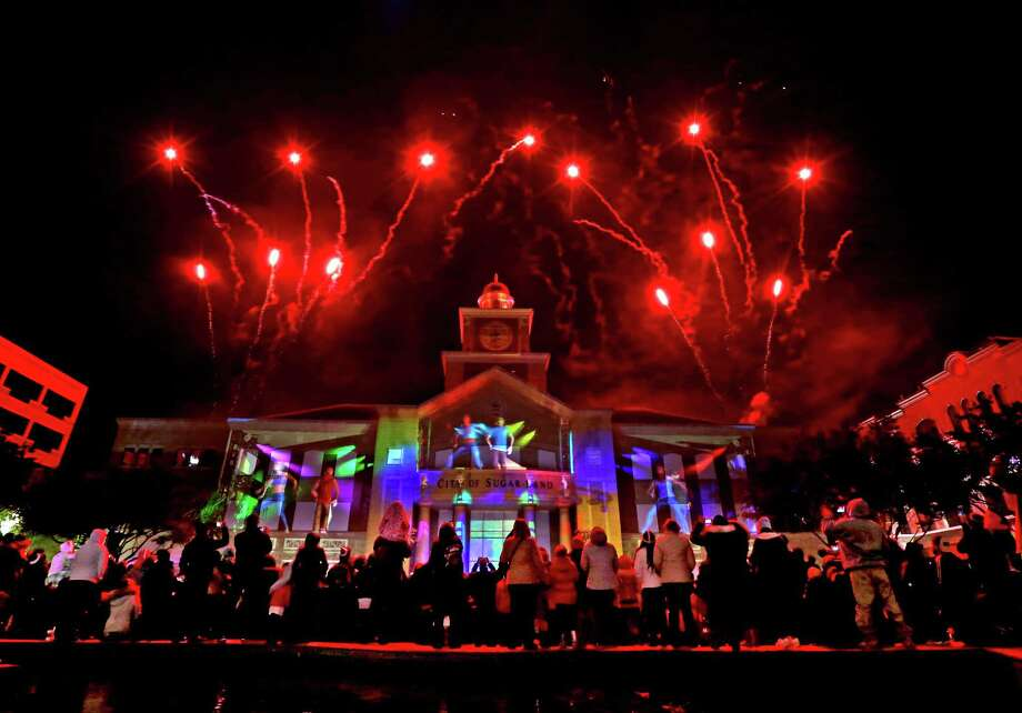 Sugar Land welcomes all residents, friends and neighbors to ring in 2016  in Sugar Land Town Square on Thursday. Photo: Gary Coronado, Staff / © 2014 Houston Chronicle