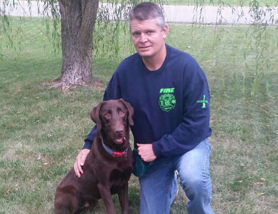 Montgomery County Crime Stoppers on Dec. 22, 2015 provided a $17,000 grant that will pay for Brody, a chocolate Labrador who is uniquely qualified to sniff out the tiniest of electronic devices that can store anything from terrorist communiques to child porn. The dog is shown here with owner/trainer Todd Jordan, a deputy fire chief in Anderson, Ind. Photo: Handout Photo