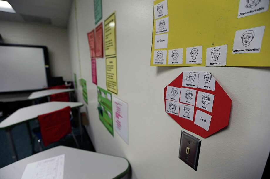 Symbols of different emotions posted in a Spring Branch ISD TOTAL (Turnaround Opportunities Through Active Learning) program classroom Monday, Nov. 23, 2015, in Houston. TOTAL (Turnaround Opportunities Through Active Learning), is an innovative type of alternative school for students with mental health challenges in the district.  ( James Nielsen / Houston Chronicle ) Photo: James Nielsen, Staff / Houston Chronicle / © 2015  Houston Chronicle