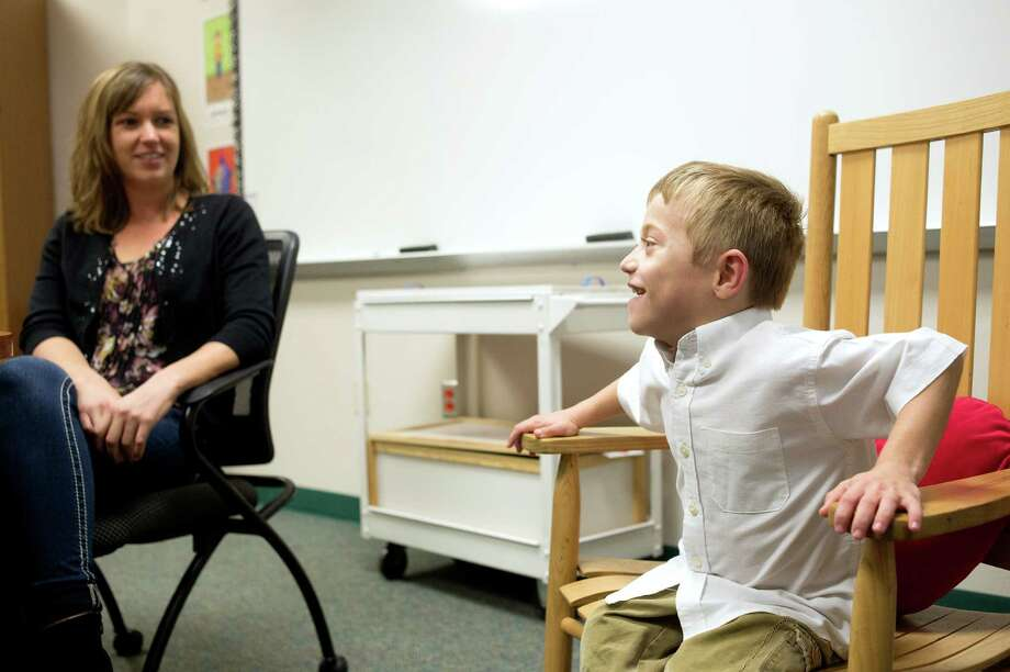 Matthew Parker sits next to his first-grade teacher Lindsey Painter, who donated a kidney to him. On Christmas Eve 2014, she learned she was a perfect match. The transplant surgery was performed the following March. Matthew, now 7, has been thriving since then. Photo: Josh Bachman /For The San Antonio Express-News / Josh Bachman