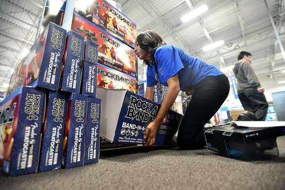 Best Buy employee Michiko Anthony retrieves a product ordered online for an in-store pickup at Best Buy in Emeryville, California on December 23, 2015. This holiday season, retailers are pursuing alternative ways to deliver orders.