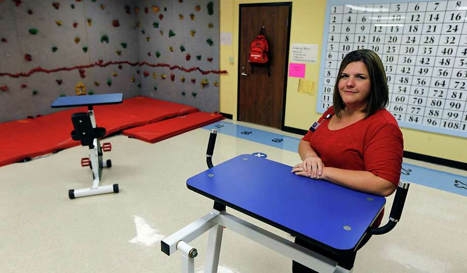 TOTAL (Turnaround Opportunities Through Active Learning) Facilitator Sara Vercher in a Spring Branch ISD TOTAL program classroom Monday, Nov. 23, 2015, in Houston. TOTAL (Turnaround Opportunities Through Active Learning), is an innovative type of alternative school for students with mental health challenges in the district. Photo: James Nielsen, Houston Chronicle / © 2015  Houston Chronicle