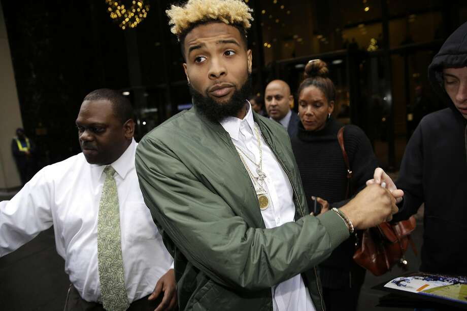 Giants wide receiver Odell Beckham Jr. leaves NFL headquarters in New York on Wednesday afternoon after siring his appeal to hearing officer James Thrash, who upheld the suspension. Photo: Seth Wenig, Associated Press