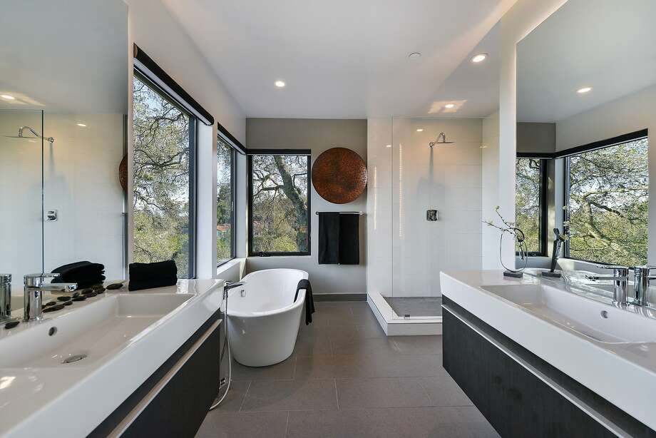 The spa-quality master suite includes floating vanities, a soaking tub and a frameless shower. Photo: Open Homes Photography