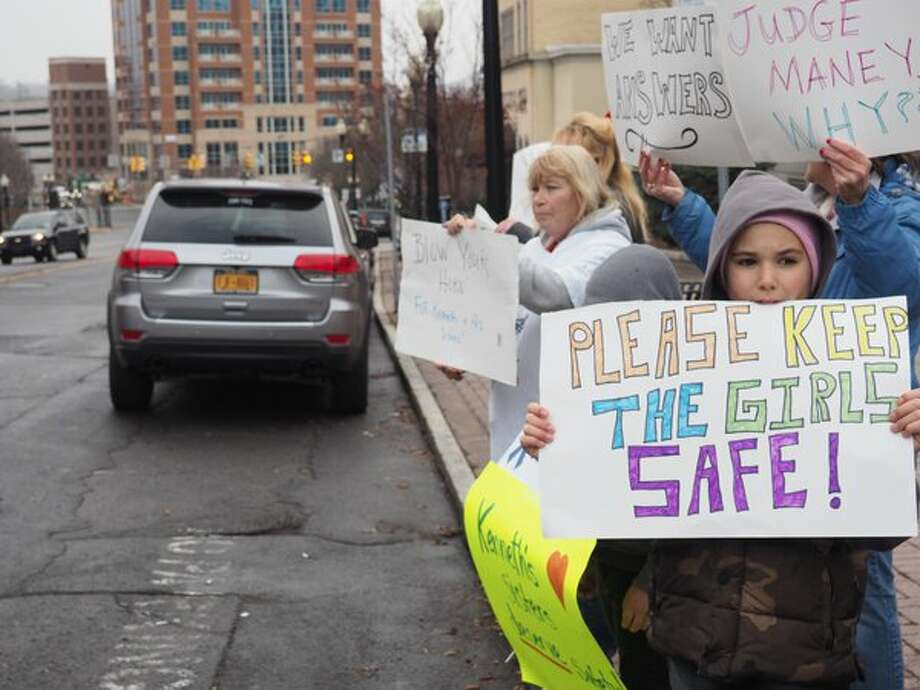 "Tyler Rider, 10, of Rensselaer protests with ""Kenneth's Army"" against decision where to place the siblings of Kenneth White, the 5-year-old boy who was killed by his then 19-year-old cousin, Tiffany VanAlstyne, inside the Knox home they shared with VanAlstyne's mother, and White's two sisters. (J.p. Lawrence / Times Union)"