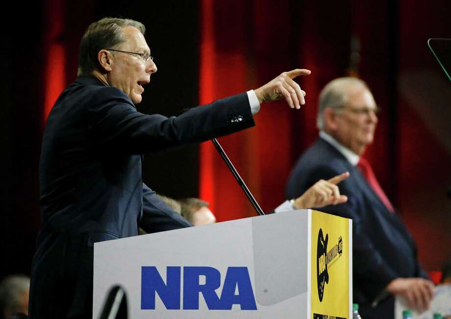 Wayne LaPierre, left, executive vice president of the National Rifle Association, speaks during the annual meeting of members at the NRA convention Saturday, April 11, 2015, in Nashville, Tenn. At right is Jim Porter, NRA president. (AP Photo/Mark Humphrey) Photo: Mark Humphrey, STF / AP