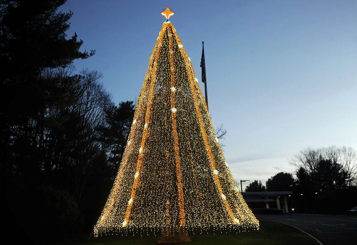 The GE Christmas tree is lit up at dusk outside outside GE Headquarters at 3135 Easton Turnpike in Fairfield, Conn. on Sunday, December 20, 2015. The tree is an exact replica of the National Christmas Tree at the White House, which GE has been designing and lighting since 1963.