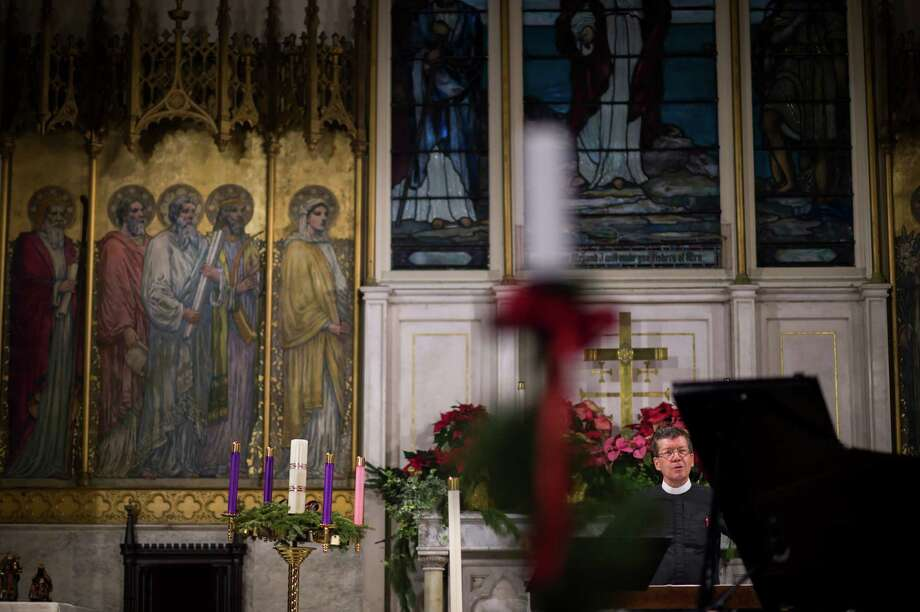 The Rev. Stephen Harding, interim pastor to an Episcopal body founded in 1831 that worships at St. Peter's Church Chelsea in Manhattan, estimates the church needs $15 million in repairs. Photo: Photos By Nancy Borowick /New York Times / NYTNS