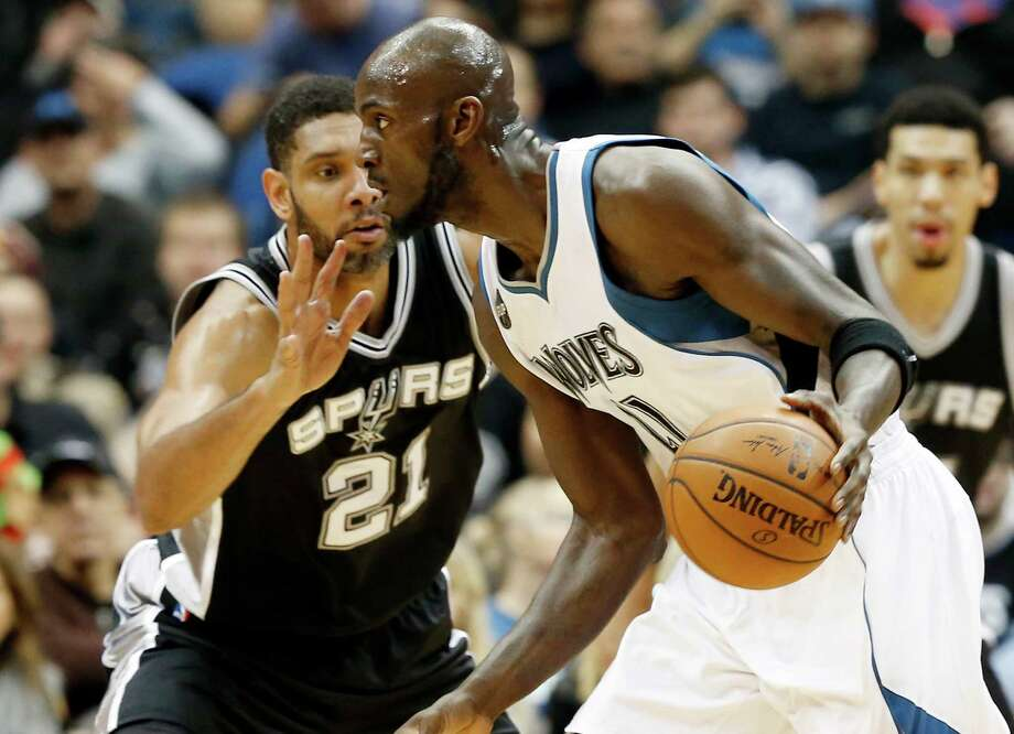 Minnesota Timberwolves' Kevin Garnett, right, drives by San Antonio Spurs' Tim Duncan in the first quarter of an NBA basketball game, Wednesday, Dec. 23, 2015, in Minneapolis. (AP Photo/Jim Mone) Photo: Jim Mone, Associated Press / AP