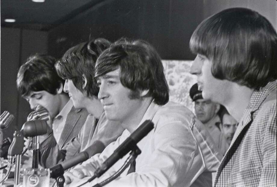 The Beatles - Paul McCartney, George Harrison, John Lennon and Ringo Starr - meet the press at a news conference in Houston before their performance at the Sam Houston Coliseum on Aug. 19, 1965. Their music is now available on streaming services worldwide. Photo: HC Staff / Houston Chronicle