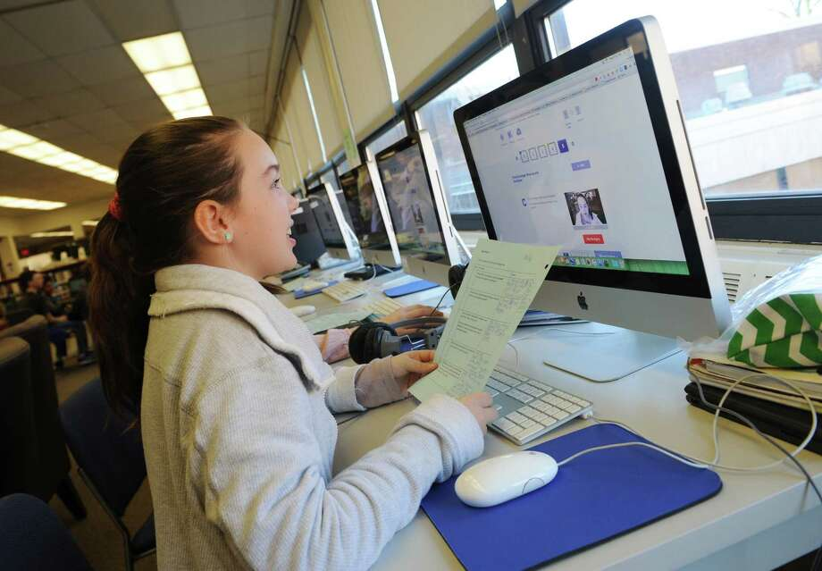 Sixth-grader Brooke Mulshine records a video for her web partner in Pakistan at Eastern Middle School in Greenwich. Sixth-grade students at Eastern Middle School have partnered with students at a middle school in Pakistan to send each other video letters about life in their respective countries. Photo: Tyler Sizemore / Hearst Connecticut Media / Greenwich Time
