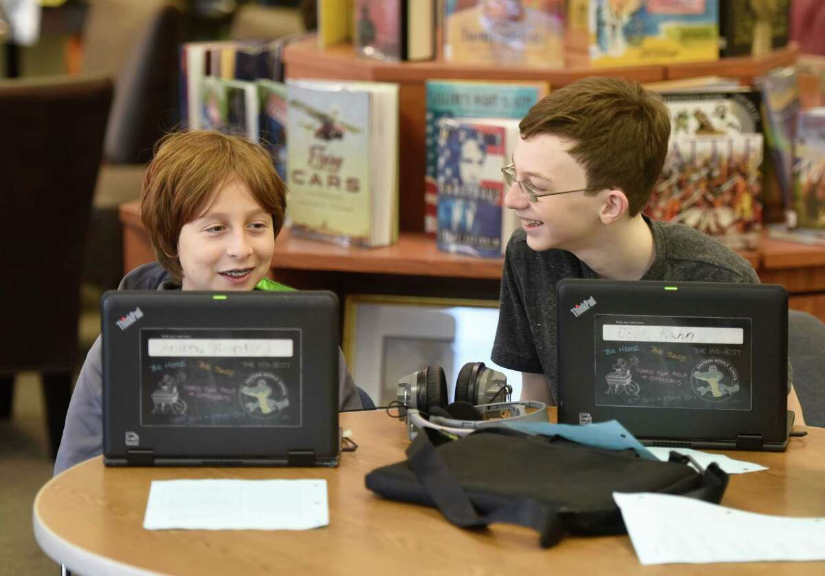 Sixth-graders Andrew Wiedling, left, and Josh Kahn record a video for their web partners in Pakistan at Eastern Middle School in Greenwich.