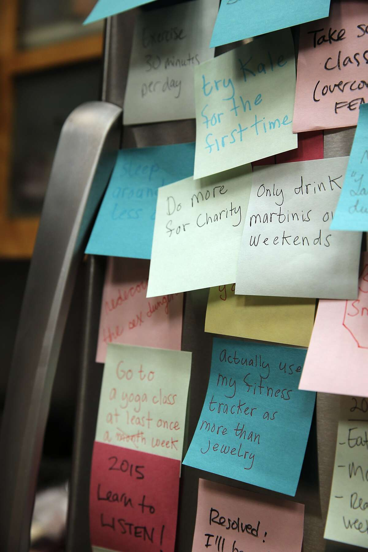 Photo illustration of post-it notes with New Year's resolutions in San Francisco, Calif., on Wednesday, December 23, 2015.
