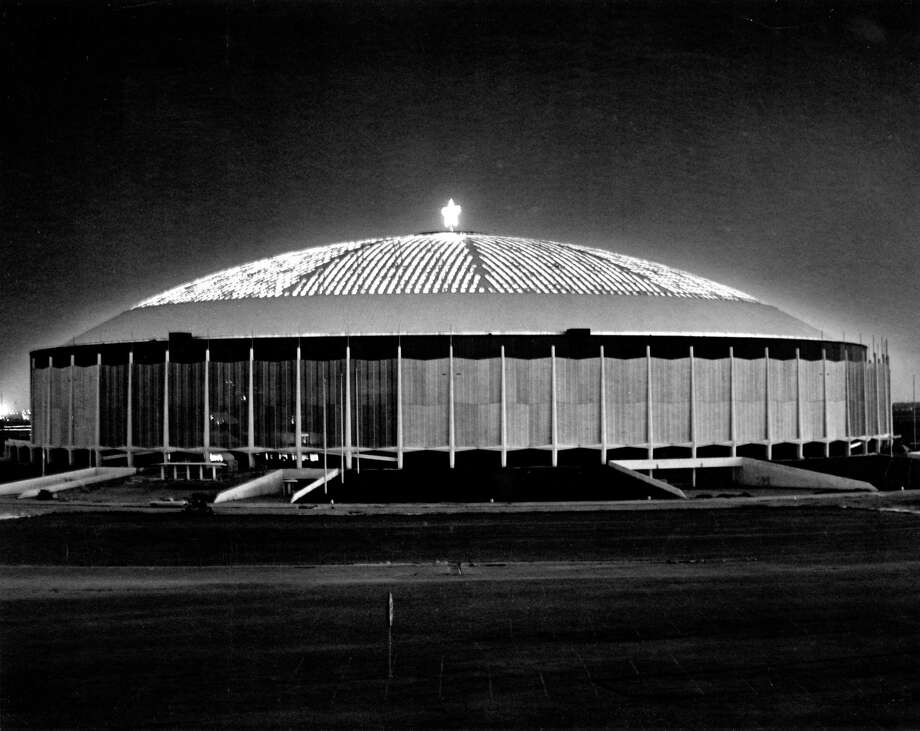 December 1964: By this time the Astrodome was just nearing completion and would open a few months later. It's sporting a holiday star at the top. Photo: Houston Chronicle Files / handout