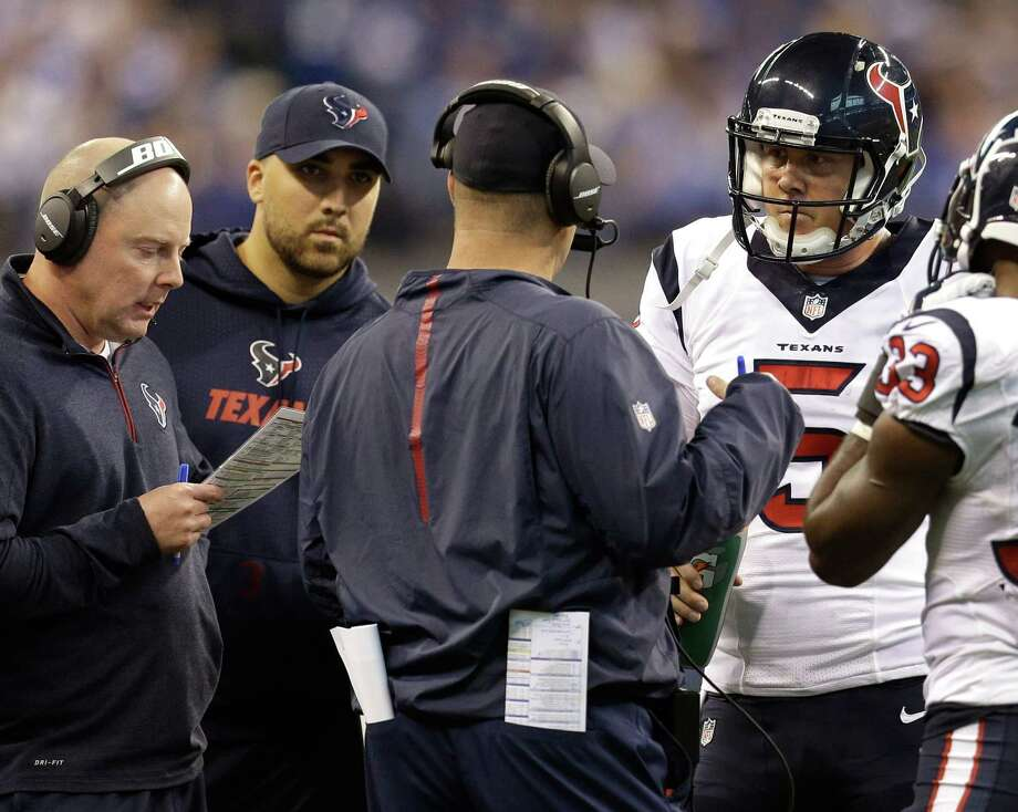 Texans offensive coordinator George Godsey and coach Bill O'Brien (in headsets) try to figure out plays that new backup  quarterback Brandon Weeden (5) can run during a timeout at Indianapolis on Sunday. Photo: Brett Coomer, Staff / © 2015  Houston Chronicle