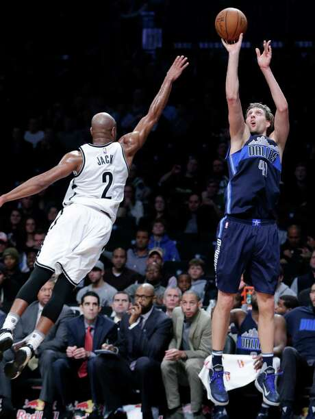Dirk Nowitzki, shooting over the Nets' Jarrett Jack, moved into sixth place on the all-time scoring list. Photo: Frank Franklin II, STF / AP