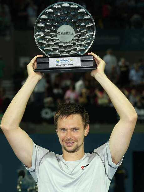 Robin Soderling of Sweden lifts the champion's trophy after beating Andy Roddick of the US in the men's final match of the Brisbane International tennis tournament in Brisbane, Australia, Sunday, Jan. 9, 2011.  (AP Photo/Tertius Pickard) Photo: Tertius Pickard, STR / AP