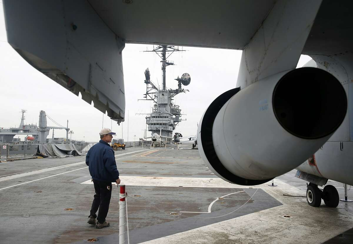 USS Hornet museum Director of Engineering/Operations Scott Zirger walks past an S-3 submarine hunter aircraft on a section of the flight deck in need of renovation in Alameda, Calif. on Tuesday, Dec. 8, 2015. Hornet museum officials are racing to repair the flight deck as quickly as possible, which leaks water to the lower decks during the rainy season, and is raising concern with predicted El Nino storm conditions approaching.