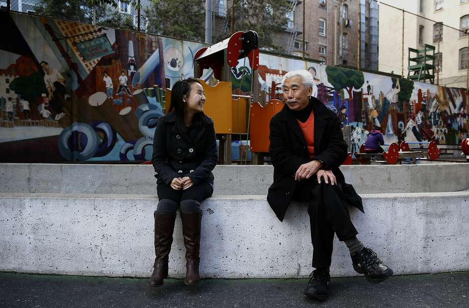 """Rosa Chen, with the Chinatown Community Development Center and Gordon Chin, the founder of the Chinatown Community Development Center talk during a visit to Chinatown's Willie """"Woo Woo"""" Wong Playground, (Chinese Playground) on Friday December 4, 2015, in San Francisco, Calif. Photo: Michael Macor, The Chronicle"""