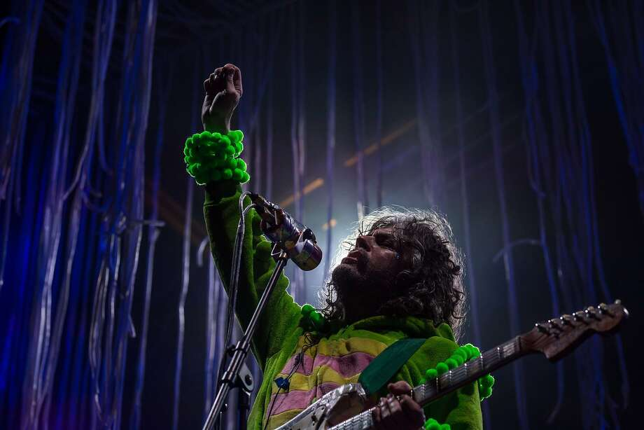 Wayne Coyne, singer of US alternative rock group The Flaming Lips, performs with his band at the annual Clockenflap music festival in the Kowloon district of Hong Kong on November 30, 2014. The city's only annual music and multimedia festival, Clockenflap aims to promote music and art in Hong Kong featuring a lineup of local, regional, and international performers. AFP PHOTO / ANTHONY WALLACEANTHONY WALLACE/AFP/Getty Images Photo: Anthony Wallace, AFP/Getty Images