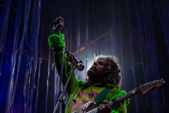 Wayne Coyne, singer of US alternative rock group The Flaming Lips, performs with his band at the annual Clockenflap music festival in the Kowloon district of Hong Kong on November 30, 2014. The city's only annual music and multimedia festival, Clockenflap aims to promote music and art in Hong Kong featuring a lineup of local, regional, and international performers. AFP PHOTO / ANTHONY WALLACEANTHONY WALLACE/AFP/Getty Images