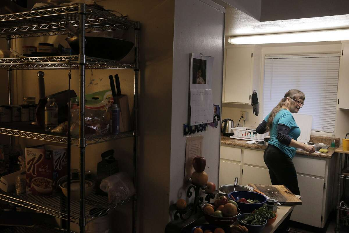 San Francisco Marin Food Bank client Karen Fabec, 65, makes soup from fresh vegetables in the apartment she shares with daughter Shandi Anderson and grandson Evan in Marin City.
