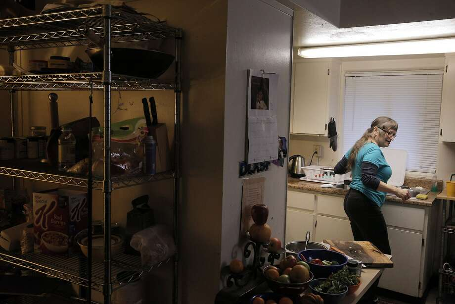 San Francisco Marin Food Bank client Karen Fabec, 65, makes soup from fresh vegetables in the apartment she shares with daughter Shandi Anderson and grandson Evan in Marin City. Photo: Carlos Avila Gonzalez, The Chronicle