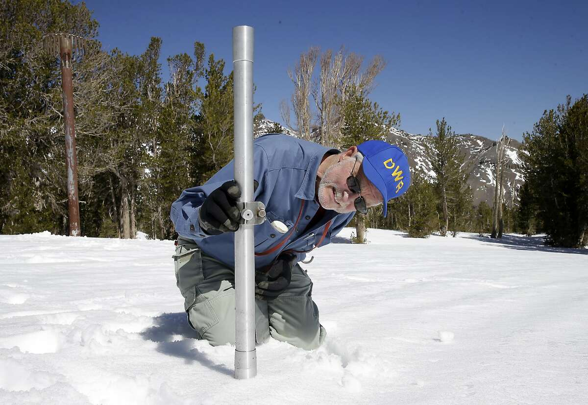 In this April 2015 file photo, Frank Gehrke, chief of the California Cooperative Snow Surveys Program for the Department of Water Resources, checks the depth of the snow pack.