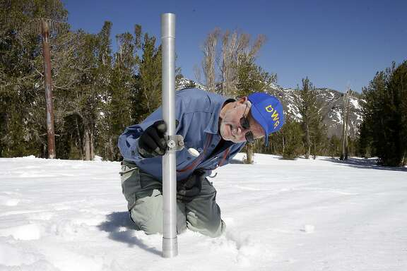 FILE - In this April 28, 2015 file photo, Frank Gehrke, chief of the California Cooperative Snow Surveys Program for the Department of Water Resources, checks the depth of the snow pack as he does a snow survey at Leavitt Lake near Bridgeport Calif. The Sierra Nevada snowpack measured above average for this time of year, but it's not enough to make a dent in California's stubborn four-year drought, state water managers said Wednesday, Dec. 23. (AP Photo/Rich Pedroncelli, File)
