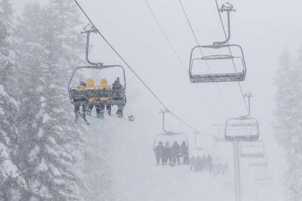 Skiers take a snowy ride Monday up the slopes at Northstar California Resort near Lake Tahoe. Weather forecasters are expecting another up to 4 feet of fresh powder Monday and into Tuesday for parts of the Sierra.