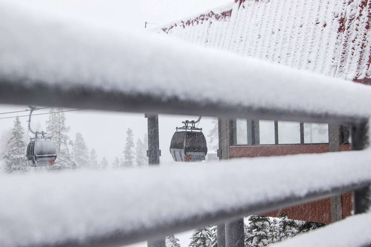 In this photo provided by Northstar California Resort, framed by snow on a railing, gondola cabins deliver skiers and snowboarders to mid-mountain at Northstar California Resort Monday, Dec. 21, 2015, in Truckee, Calif. Winter storm warnings were posted Monday in the Sierra Nevada after the National Weather Service predicted heavy mountain snow during the holiday week. A storm moving into the northern Sierra was expected to drop more than an inch of snow an hour at times. (Northstar California Resort via AP)