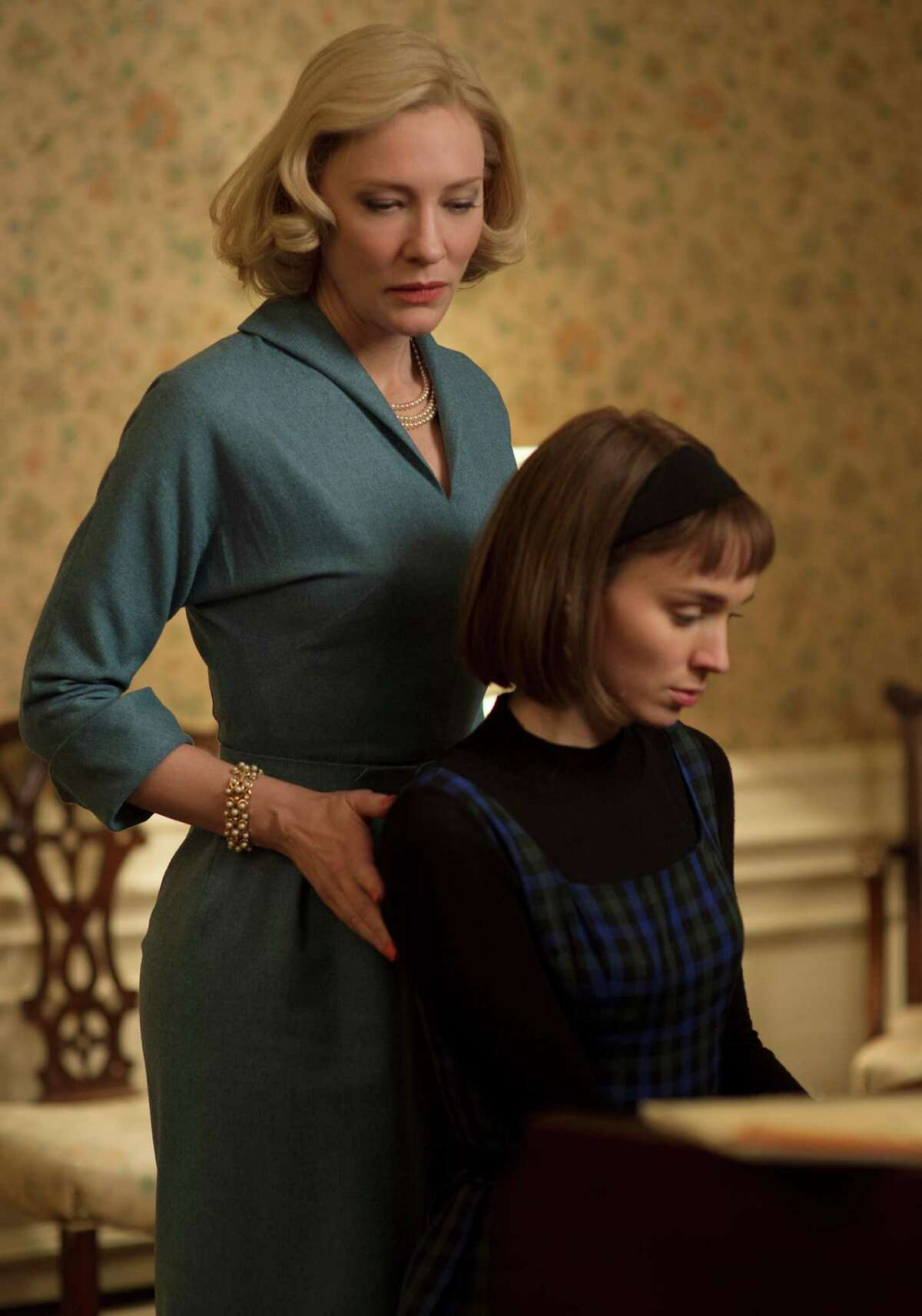 """This photo provided by The Weinstein Company shows Cate Blanchett, left, and Rooney Mara in a scene from the film, """"Carol."""" AP film writers Jake Coyle and Lindsey Bahr select their picks for the best movies of the year in 2015, including """"Ex Machina,"""" """"Carol,"""" """"Kumiko, The Treasure Hunter,"""" """"Spotlight,"""" and others. (Wilson Webb/The Weinstein Company via AP)"""