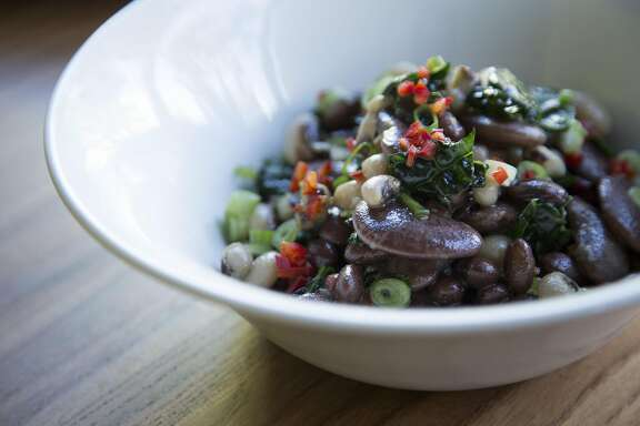 Rancho gored beans with heirloom varietal beans, chilies,  lemon scallion vinaigrette at Little Gem, Thursday, Dec. 24, 2015, in San Francisco, Calif.